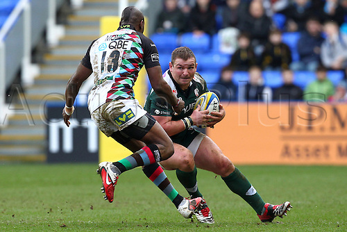 26.02.2011 Hooker James Buckland  in possession for London Irish and looking to get past Harlequin's Centre Ugo Monye Aviva Premiership Rugby from the Madejski Stadium. London Irish v Harlequins.