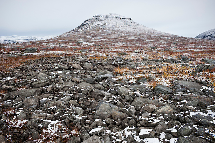 Rocky arctic terrain and autumn snow along Kungsleden trail, Lapland, Sweden