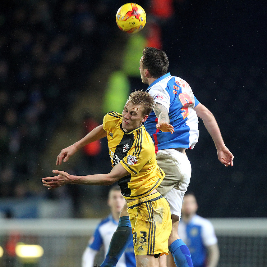 Blackburn Rovers Chris Brown jumps with Fulham's Dan Burn<br />