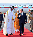 Egyptian President Abdel Fattah al-Sis walks with Abu Dhabi Crown Prince Sheikh Mohammed bin Zayed al-Nahyan after he arrives in Cairo International Airport on June 19, 2017. Photo by Egyptian President Office
