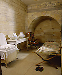 The Turkish Baths at Cragside, Northumberland showing the dressing area including the lounger and screens.