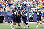 Yale players celebrate the win with goalkeeper Jack Starr  (#23) as Yale defeats UAlbany 20-11 in the NCAAA semifinal game at Gillette Stadium, May 26.
