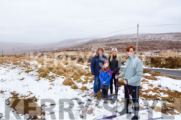 On top of the snowy mountain in Tralee and on the skis is David Boyle with his father Alan, Keira and Grace Boyle.