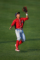 Williamsport Crosscutters left fielder Enmanuel Garcia (15) catches a fly ball during a game against the Auburn Doubledays on June 26, 2016 at Falcon Park in Auburn, New York.  Auburn defeated Williamsport 3-1.  (Mike Janes/Four Seam Images)