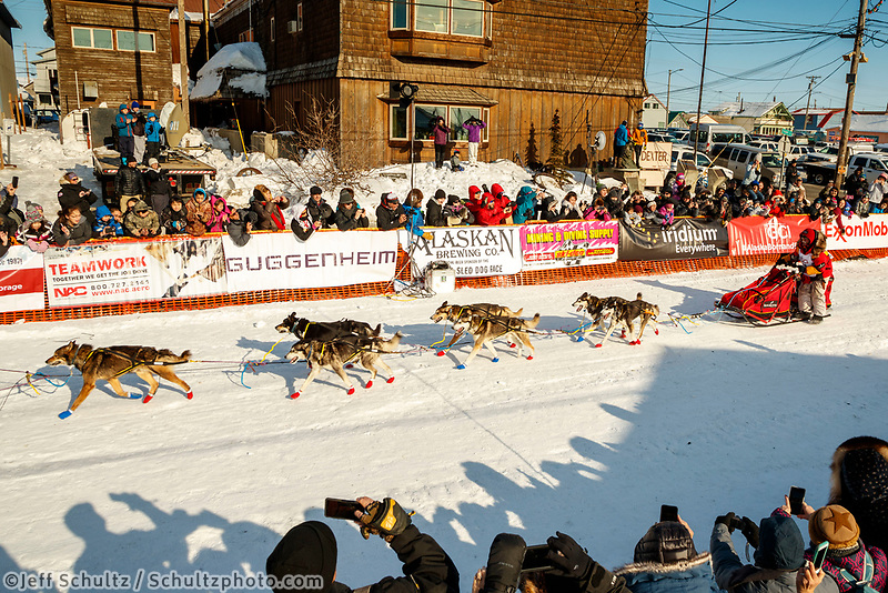 Mitch Seavey runs down the chute and crosses the finish line to win his third Iditarod in record time of 8 days, 3 hours, 40 minutes and 13 seconds in Nome during the 2017 Iditarod on Tuesday afternoon March 14, 2017.<br /> <br /> Photo by Jeff Schultz/SchultzPhoto.com  (C) 2017  ALL RIGHTS RESERVED