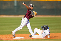 Second baseman Jesse Mesa #1 of the College of Charleston Cougars turns a double play against the Davidson Wildcats at Wilson Field on March 12, 2011 in Davidson, North Carolina.  The Wildcats defeated the Cougars 8-3.  Photo by Brian Westerholt / Four Seam Images