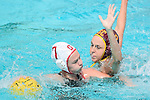 LOS ANGELES, CA - MAY 13: Denise Mammolito #8 of the University of Southern California makes contact with Jordan Raney #7 of Stanford University during the Division I Women's Water Polo Championship held at the Uytengsu Aquatics Center on the USC campus on May 13, 2018 in Los Angeles, California. USC defeated Stanford 5-4. (Photo by Tim Nwachukwu/NCAA Photos via Getty Images)