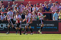 Billy Waters of Cheltenham  (far right) celebrates scoring his side's equalising goa; during the Sky Bet League 2 match between Cheltenham Town and Leyton Orient at the LCI Rail Stadium, Cheltenham, England on 6 August 2016. Photo by Mark  Hawkins / PRiME Media Images.