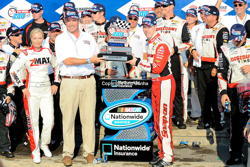 July 14 2012 Nationwide Series driver Brad Keselowski (22) accepts the winners trophy at the F.W. Webb 200 with his team at the New Hampshire Motor Speedway in Loudon New Hampshire. Eric Canha/CSM