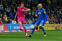 Jordan Williams of Rochdale AFC and Joe Pigott of AFC Wimbledon during AFC Wimbledon vs Rochdale, Sky Bet EFL League 1 Football at the Cherry Red Records Stadium on 5th October 2019