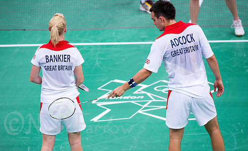 28 JUL 2012 - LONDON, GBR - Imogen Bankier (GBR) and partner Chris Adcock (GBR) of Great Britain wait to receive service during the London 2012 Olympic Games mixed doubles group badminton match against Alexandr Nikolaenko and Valeria Sorokina of Russia at Wembley Arena, London, Great Britain .(PHOTO (C) 2012 NIGEL FARROW)
