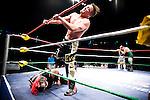 Lucha Libre AAA wrestler Jack Evans kicks Crazyboy at a match in Sacramento, CA March 28, 2009.