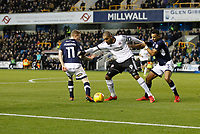 Leon Clarke of Sheffield United holds off Shane Ferguson and James Meredith of Millwall during the Sky Bet Championship match between Millwall and Sheff United at The Den, London, England on 2 December 2017. Photo by Carlton Myrie / PRiME Media Images.