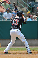 Eddie Rosario (13) of the New Britain Rock Cats bats during a game against the Altoona Curve at New Britain Stadium on June 25, 2014 in New Britain, Connecticut.  New Britain defeated Altoona 3-1.  (Gregory Vasil/Four Seam Images)