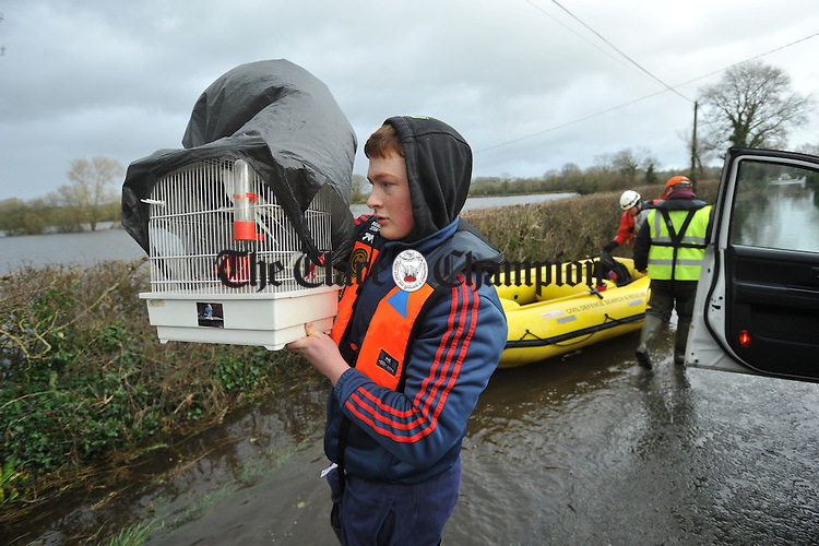 Sean Hogan  arrives with his pet birds after he, his brother Mark and their dad Michael were evacuated, by emergency services, from their home  at Springfield, Clonlara where they were cut off due to high flood water levels. Photograph by John Kelly.