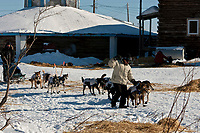First-year volunteer Bill Piccolo helps guide Tom Lesatz to a parking spot at the Kaltag checkpoint during the 2010 Iditarod
