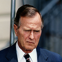 ***FILE PHOTO*** George H.W. Bush Has Passed Away<br /> Washington, DC., USA, 1991<br /> President George H.W. Bush delivers a statement while standing at the South Diplomatic entance to the White House. <br /> CAP/MPI/MRN<br /> &copy;MRN/MPI/Capital Pictures