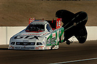 Apr 8, 2006; Las Vegas, NV, USA; NHRA Funny Car driver John Force, driver the Castrol GTX Ford Mustang slows to a stop after qualifying for the Summitracing.com Nationals at Las Vegas Motor Speedway in Las Vegas, NV. Mandatory Credit: Mark J. Rebilas