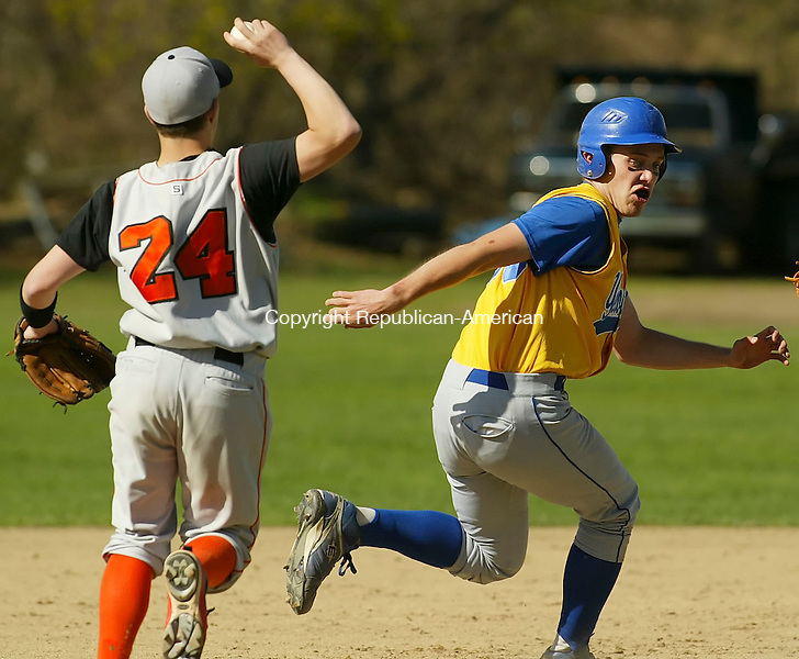 WINSTED, CT 4/30/07- 043007BZ05- Gilbert's Sam Serafini (30) tries, unsuccessfully, to evade Terryville's James Mullaly (24) during a rundown between second and third<br /> during their game at Walker Field in Winsted Monday.<br /> Jamison C. Bazinet Republican-American