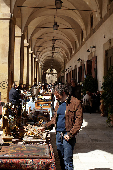 An antiques fair has been set up in the colonnade around the central piazza in Foligno