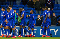 Junior Hoilett of Cardiff City (centre) celebrates after scoring his side's second goal during the Sky Bet Championship match between Cardiff City and Norwich City at the Cardiff City Stadium, Cardiff, Wales on 1 December 2017. Photo by Mark  Hawkins / PRiME Media Images.