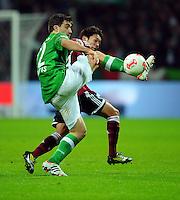 FUSSBALL   1. BUNDESLIGA    SAISON 2012/2013    17. Spieltag   SV Werder Bremen - 1. FC Nuernberg                     16.12.2012 Sokratis Papastathopoulos (SV Werder Bremen) gegen Hiroshi Kiyotake (re, 1 FC Nuernberg)