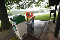 NWA Democrat-Gazette/FLIP PUTTHOFF <br />RAINY DAY CHORES<br />John Brown with Arkansas Highway and Transportation Department slips new bags into trash receptacles Wednesday May 3 2017 at the Arkansas Welcome Center on U.S. 71  in Bella Vista. Thirteen Arkansas Welcome Centers are located at points of entry into the state, including Siloam Springs. The centers offer a rest stop for travelers as well as maps and information about area attractions.