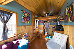 Kol Peterson, one of the owners of the Caravan Tiny House Hotel, inside the tiny house called Kangablue, Portland, OR, USA