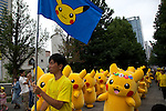 "20 Pikachus march on the street during the parade at the ""1000 Pikachu Outbreak! at Yokohama Minatomirai"" on August 09, 2014. 1000 Pikachu performed at different areas of Minatomirai in Yokohama during the summer vacation event from August 9 to 17.  (Photo by Rodrigo Reyes Marin/AFLO)"