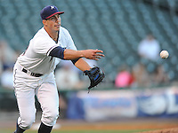 NWA Democrat-Gazette/ANDY SHUPE<br /> Northwest Arkansas Naturals starter Kyle Zimmer underhands the ball Wednesday, Aug. 12, 2015, to first base against San Antonio at Arvest Ballpark in Springdale.
