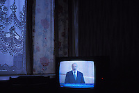 BELAZIORSK, BELARUS - MAY 6: Belarusian president Alexander Lukashenko is seen on television in a hotel room on May 6, 2004 in Belaziorsk, Belarus. For years, Belarus was frozen in its communist past. Now the radical change that has swept the former Soviet Union -- from Georgia's 2003 popular uprising to Ukraine's orange revolution last winter to the recent meltdown in Kyrgyzstan -- is catching up with President Alexander Lukashenko, a dictator whose regime has been described as Stalinism minus the Gulag. The images here capture a country and a people inexorably moving toward revolution: Student activists organizing illegally, democratic reformers meeting in rusting warehouses, protesters holding pictures of 'enemies of the state' murdered by the security services. Just beneath the apparent ordinariness and staidness of this post-Soviet republic, which is barely distinguishable from its former Soviet self, is a deep and powerful anger and a yearning for a new politics and a new possibility. That is the crux of Belarus today -- anger and yearning held together by the glimmer of a hope that tomorrow the regime may tumble. (Photo by Landon Nordeman)