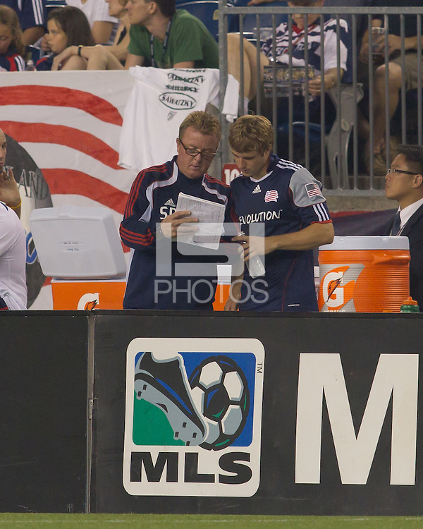 New England Revolution head coach Steve Nicol and New England Revolution midfielder Jason Griffiths (16) discuss strategy before Jason Griffiths enters the match. The Chicago Fire defeated the New England Revolution, 1-0, at Gillette Stadium on June 27, 2010.