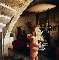 The interior of artist Gerard Drouillet's townhouse in the centre of Eygalieres. The house is typical of the south of France and the rooms are filled with his artwork and original 1950's, 60's and 70's designer furniture.