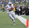 Nov 13, 2010; Columbia, MO, USA; Kansas State Wildcats running back Daniel Thomas goes in for a touchdown in the first half as Missouri Tigers safety Kenji Jackson attempts coverage at Memorial Stadium. Mandatory Credit: Denny Medley-US PRESSWIRE