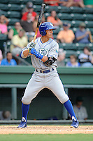 First baseman Mark Threlkeld (26) of the Lexington Legends bats in a game against the Greenville Drive on Sunday, July 21, 2013, at Fluor Field at the West End in Greenville, South Carolina. Lexington won, 2-0. (Tom Priddy/Four Seam Images)