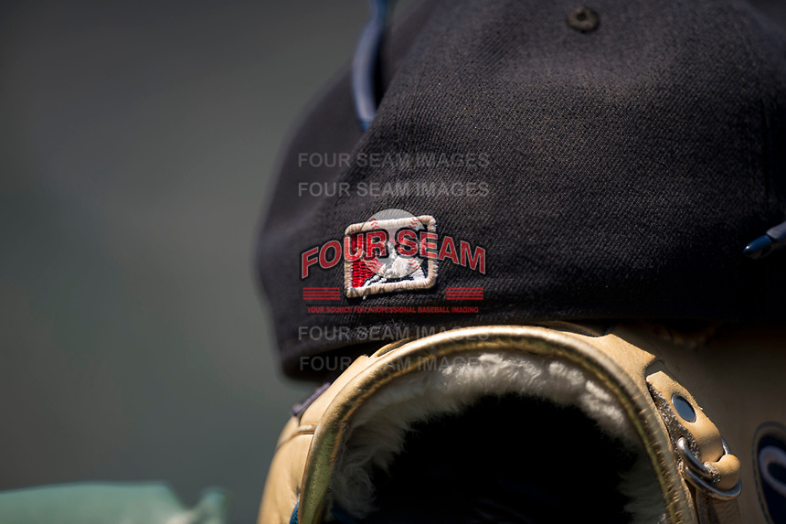 The Minor League Baseball logo on the back of a baseball cap during a Pacific Coast League game between the Tacoma Rainiers and the Sacramento RiverCats at Raley Field on May 15, 2018 in Sacramento, California. Tacoma defeated Sacramento 8-5. (Zachary Lucy/Four Seam Images)