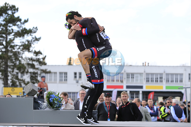 Winner John Degenkolb (GER) Giant-Alpecin hugs team mate Roy Curvers (NED) on the podium in the famous Roubaix Velodrome at the end of the 113th edition of the Paris-Roubaix 2015 cycle race held over the cobbled roads of Northern France. 12th April 2015.<br /> Photo: Eoin Clarke www.newsfile.ie