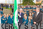 Minister Batt O'Keeffe raises the Green Flag at the official opening of Holy Family NS Rathmore on Friday