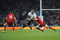 Nemani Nadolo of Fiji is tackled by Ben Morgan of England as George Ford of England awaits during Match 1 of the Rugby World Cup 2015 between England and Fiji - 18/09/2015 - Twickenham Stadium, London <br /> Mandatory Credit: Rob Munro/Stewart Communications