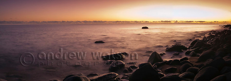 Dawn over the Coral Sea at Pebbly Beach, near Cairns, Queensland, Australia