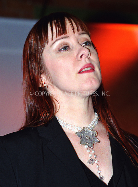 """SUZANNE VEGA performing live at the Volvo's 75th anniversary party at the Times Square Studios in New York which is home to a popular TV show """"Good Morning America."""" March 28, 2002. © 2002 by Alecsey Boldeskul/NY Photo Press.   ..*PAY-PER-USE*      ....NY Photo Press:  ..phone (646) 267-6913;   ..e-mail: info@nyphotopress.com"""
