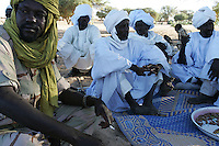 SLA (sudan liberation army) head commander general Juma Haggar attends the celebrations for the end of ramadan with the village leaders in Musbat on Nov 2004