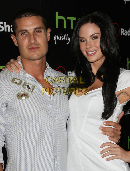 Guest & Jayde Nicole.Radioshack's HTC EVO 3D Launch Party  Held At The RadioShack Pop-Up 3D Lounge, West HollywooD, California, USA, 23rd June 2011..half length dress hand on hip cleavage white .CAP/ADM/KB.©Kevan Brooks/AdMedia/Capital Pictures.