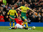 Anthony Martial of Manchester United tackles Christoph Zimmermann of Norwich City during the Premier League match at Old Trafford, Manchester. Picture date: 11th January 2020. Picture credit should read: James Wilson/Sportimage