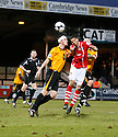 Nat Knight-Percival of Wrexham challenges for a header with Rory McAuley of Cambridge United during the Blue Square Bet Premier match between Cambridge United and Wrexham at the Abbey Stadium, Cambridge on 22nd January, 2011 .© Kevin Coleman 2011