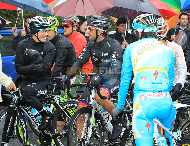 The remaining riders take shelter in a forecourt as they wait for the race to restart in Cogoleto after heavy snow forces the race organizers to abandon part of the race over Passo del Turchino during the 104th edition of the Milan-San Remo cycle race, 17th March 2013 (Photo by Eoin Clarke 2013)