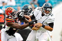October 09, 2011:   Jacksonville Jaguars quarterback Blaine Gabbert (11) is sacked by Cincinnati Bengals defensive end Robert Geathers (91) during second quarter action between the Jacksonville Jaguars and the Cincinnati Bengals played at EverBank Field in Jacksonville, Florida.  ........