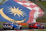 KUALA LUMPUR, MALAYSIA - May 29:  Claire Jedrek of Singapore (#82) and Aun Yue Wei of Malaysia (#66) Malaysia Championship Series Round 1 at Sepang International Circuit on May 29, 2016 in Kuala Lumpur, Malaysia. Photo by Peter Lim/PhotoDesk.com.my