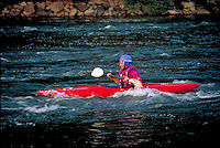 A kayaker paddles in fast water on the Susquehanna River. Kayaker. Harrisburg Pennsylvania United States Susquehanna River.