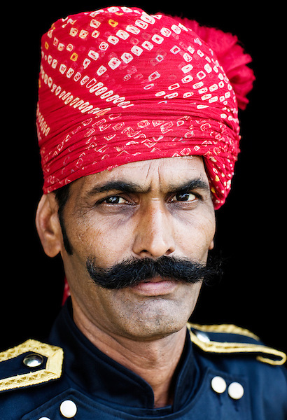 Portrait of Man in Turban, Ananda in the Himalayas, The Palace Estate, Narendra Nagar, Tehri Garhwal, Uttarakhand, India. An Indian darban in traditional garb. Darban is the traditional name given by the maharaja to the person stationed at the main gate of the palace to welcome guests.